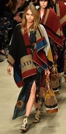 Cara, Suki and Jourdan sport monogrammed ponchos for Burberry finale