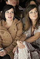 Sister act: Lily Allen and her bump join Aunt Sarah in the front row